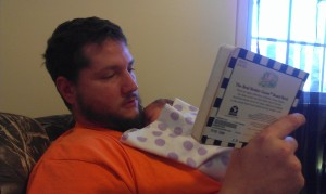 This is daddy reading to baby!!! He loves reading all her little books. Right now, Talia basically just sleeps through it all!